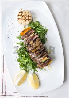 shashlik with potherbs on the plate shashlik with potherbs on the plate