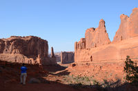 Young Female Taking a Photo of Park Avenue in Arches National Park