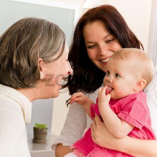 Happy family women - grandmother, mum and baby