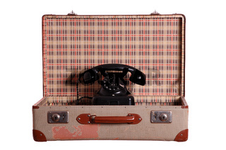 old suitcase with aged phone