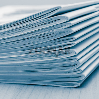 Stack of white journals