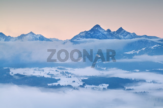 Alps in morning winter fog