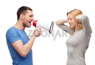 boyfriend screaming though megaphone at girlfriend