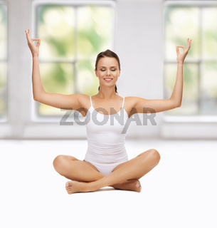 young woman doing exercises, yoga, pilates