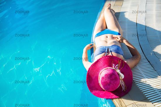 Young woman enjoying a swimming pool