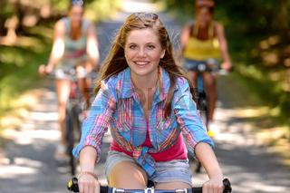 Teenage girl riding bike with friends