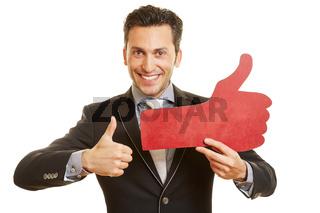 Geschäftsmann hält Social Media Daumen hoch
