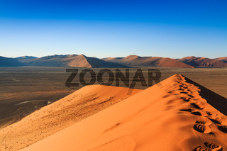 Reaching top red dune of always shifting sand. Sossusvlei