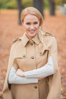 Beautiful Blond Woman in Brown Autumn Outfit