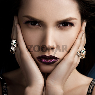 elegant fashionable woman with rings