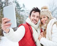 Paar macht Selbstportrait mit Tablet PC