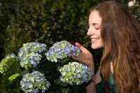 Woman smelling at hydrangea flower