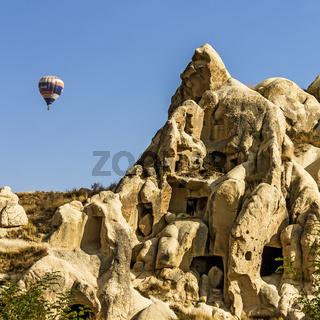 Balloon Over Rock Houses Cappadocia Turkey