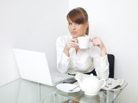Serious Office Woman Having Coffee While Working
