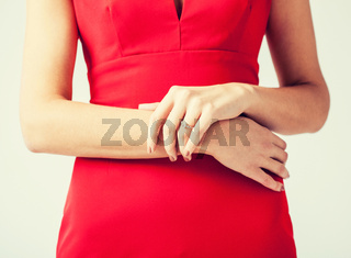 woman showing wedding ring on her hand