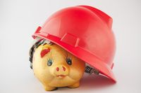 Piggy bank in helmet