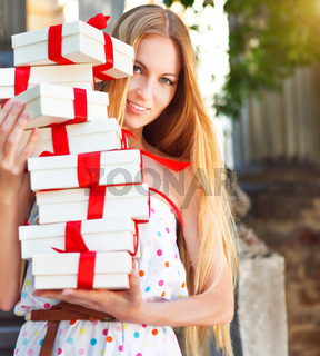 Gift boxes in the hands of young blond woman