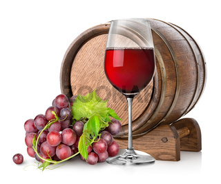 Wineglass with grape and barrel