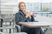 Woman in Black Fashion Having Coffee at Cafe