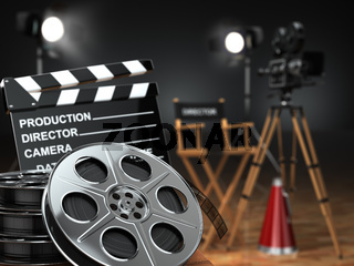 Video, movie, cinema concept. Retro camera, reels, clapperboard and director chair.