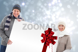 Winter couple showing a poster