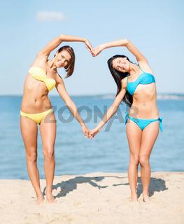 girls having fun on the beach