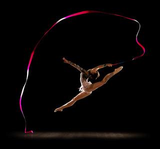 Girl engaged art gymnastics isolated