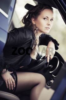 Fashion woman sitting in a car