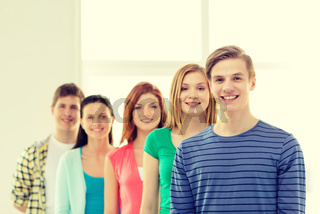 smiling students with teenage boy in front