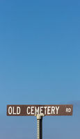 Old Cemetery Road Sign in Vertical