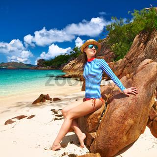 Woman at beautiful beach wearing rash guard