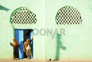 veiled girls by mosque in harar ethiopia