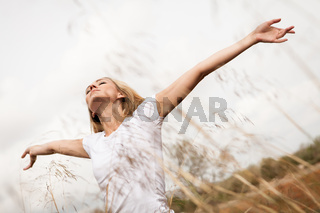 young happy attractive woman arms wide open