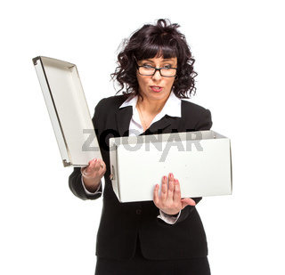 Portrait of mature woman with box, wearing glasses, looking at camera.