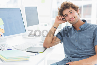 Smiling casual man in a bright office