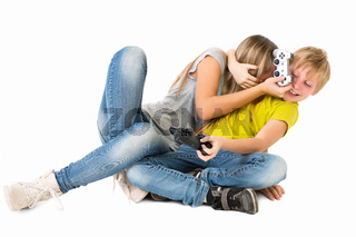 Boy and girl playing a video game and fight