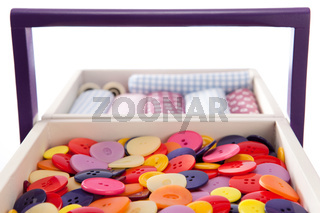 Buttons and textile fabrics in a sewing box