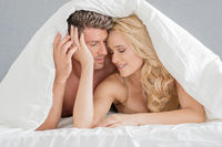 Sweet Young Couple on Bed Fashion Shoot