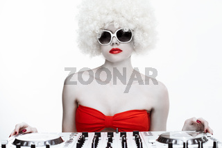 Portrait of a cool sexy female DJ, on white