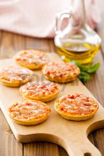 mini pizza on cutting board