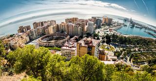 Panoramic view of Malaga bullring and harbor. Spain
