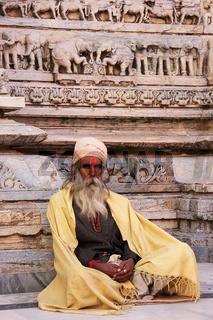 Indian man sitting at Jagdish temple, Udaipur, India