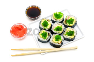 Japanese rolls on a plate on white background