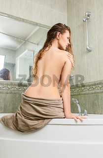 Young woman in bath