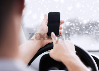 close up of man using smartphone while driving car