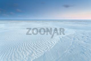 sand dunes on North sea coast during sunrise