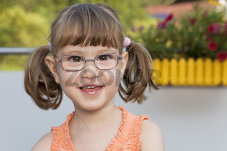 Little girl with glasses is happy