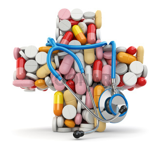 Concept of medicine. Cross from pills and stethoscope.