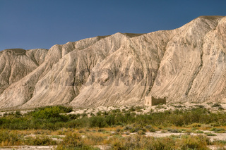 Old ruins of ancient temple under cliff in Kyrgyzstan