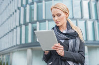 Young businesswoman checking her tablet